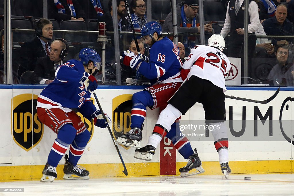 Chris Neil of the Ottawa Senators checks Derick Brassard of the New York Rangers in the first period during their game at Madison Square Garden on...