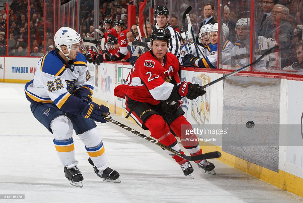Chris Neil of the Ottawa Senators chips the puck past Kevin Shattenkirk of the St Louis Blues along the boards at Canadian Tire Centre on March 1...