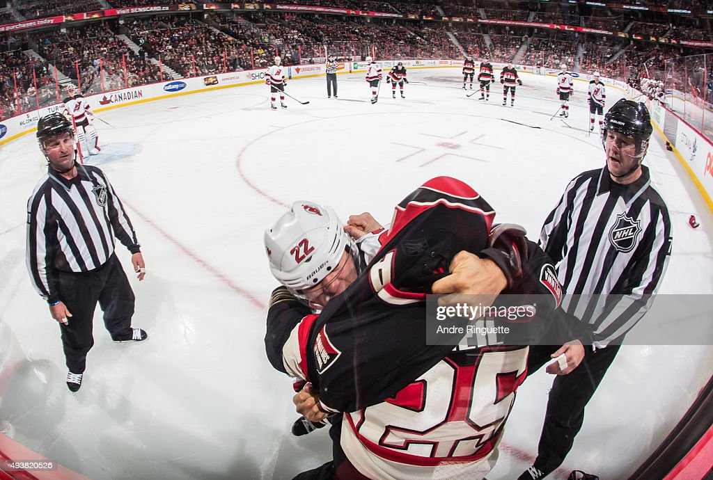 Chris Neil of the Ottawa Senators completes his 'Gordie Howe hat trick' after fighting Jordin Tootoo of the New Jersey Devils at Canadian Tire Centre...