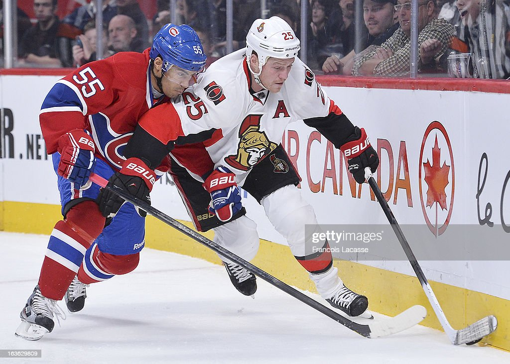 Chris Neil #25 of the Ottawa Senators fights off defenseman <a gi-track='captionPersonalityLinkClicked' href=/galleries/search?phrase=Francis+Bouillon&family=editorial&specificpeople=215165 ng-click='$event.stopPropagation()'>Francis Bouillon</a> #55 of the Montreal Canadiens during the NHL game on March 13, 2013 at the Bell Centre in Montreal, Quebec, Canada.