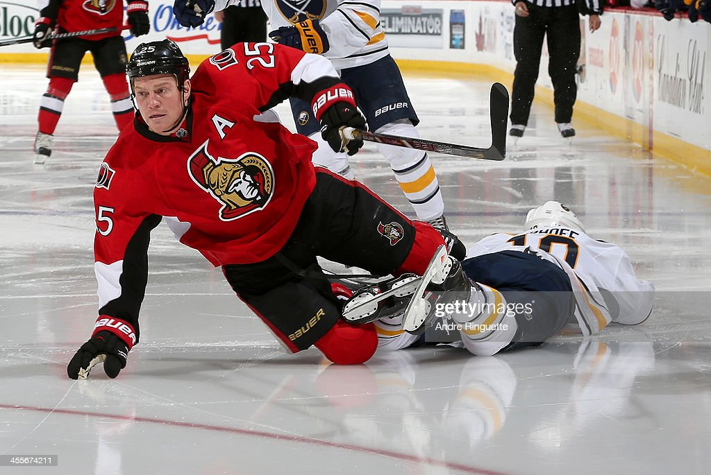 Chris Neil #25 of the Ottawa Senators gets tangled up and falls to the ice with <a gi-track='captionPersonalityLinkClicked' href=/galleries/search?phrase=Christian+Ehrhoff&family=editorial&specificpeople=214788 ng-click='$event.stopPropagation()'>Christian Ehrhoff</a> #10 of the Buffalo Sabres at Canadian Tire Centre on December 12, 2013 in Ottawa, Ontario, Canada.