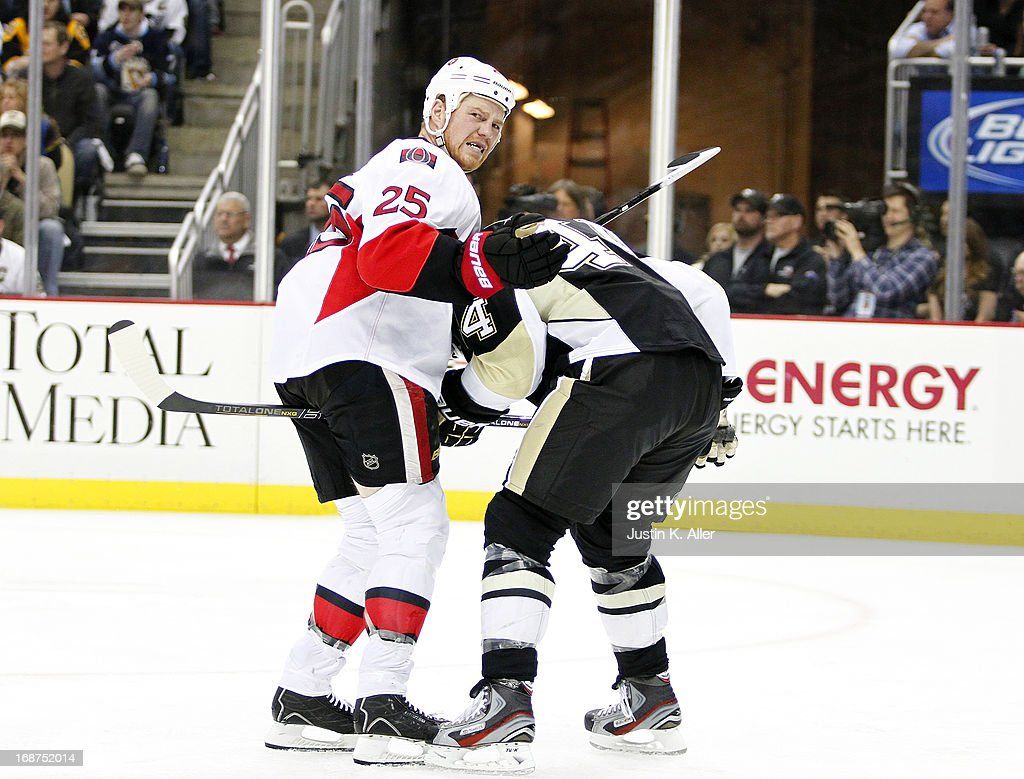 Chris Neil #25 of the Ottawa Senators gets tangled up with Brooks Orpik #44 of the Pittsburgh Penguins in Game One of the Eastern Conference Semifinals during the 2013 NHL Stanley Cup Playoffs at Consol Energy Center on May 14, 2013 in Pittsburgh, Pennsylvania. The Penguins defeated the Senators 4-1.