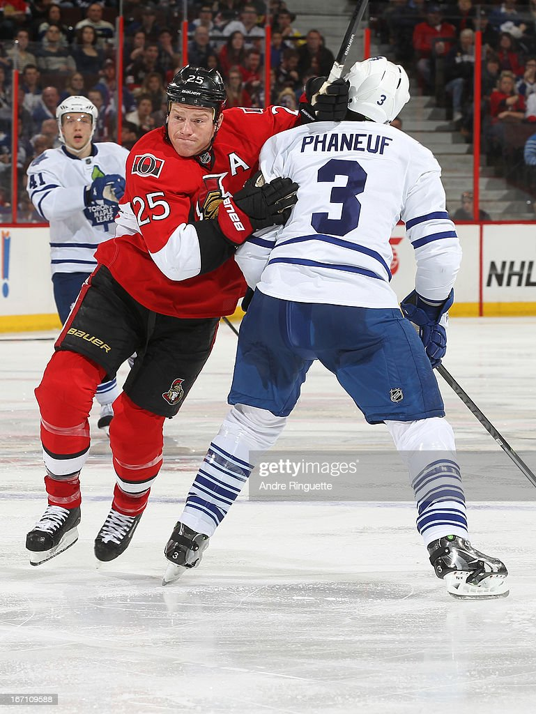 Chris Neil #25 of the Ottawa Senators gives shoves his way by <a gi-track='captionPersonalityLinkClicked' href=/galleries/search?phrase=Dion+Phaneuf&family=editorial&specificpeople=545455 ng-click='$event.stopPropagation()'>Dion Phaneuf</a> #3 of the Toronto Maple Leafs you get open on April 20, 2013 at Scotiabank Place in Ottawa, Ontario, Canada.