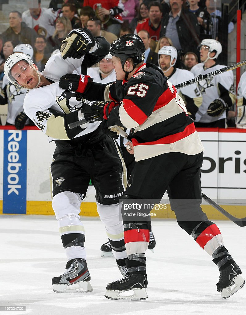Chris Neil #25 of the Ottawa Senators jostles with Brooks Orpik #44 of the Pittsburgh Penguins in first period action on April 22, 2013 at Scotiabank Place in Ottawa, Ontario, Canada.