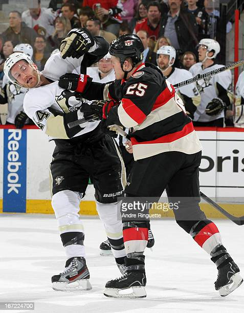 Chris Neil of the Ottawa Senators jostles with Brooks Orpik of the Pittsburgh Penguins in first period action on April 22 2013 at Scotiabank Place in...