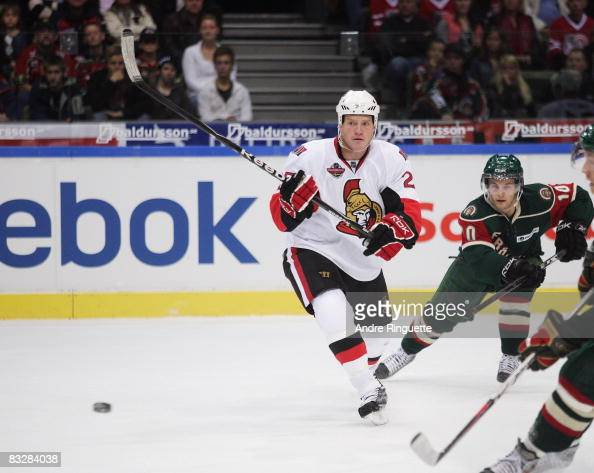 Chris Neil of the Ottawa Senators passes the puck against the Frolunda Indians at Scandinavium Arena on October 2 2008 in Gothenburg Sweden