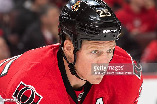 Chris Neil of the Ottawa Senators prepares for a faceoff against the New York Rangers during an NHL game at Canadian Tire Centre on November 14 2015...