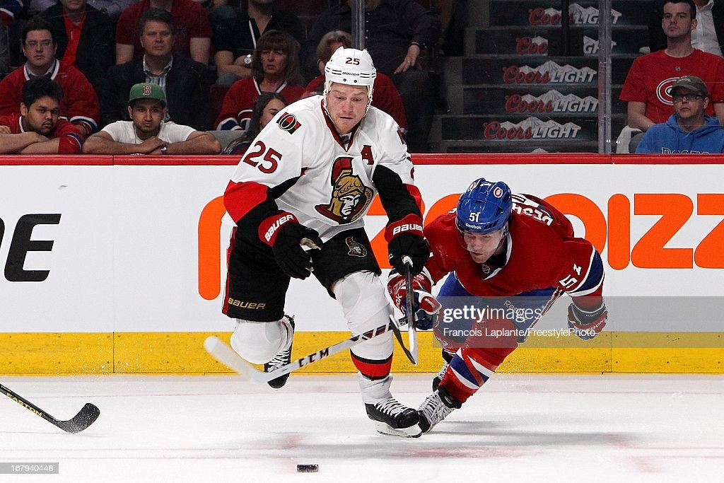 Chris Neil #25 of the Ottawa Senators races for a loos puck against David Desharnais #51 of the Montreal Canadiens in Game One of the Eastern Conference Quarterfinal during the 2013 NHL Stanley Cup Playoffs at the Bell Centre on May 2, 2013 in Montreal, Quebec, Canada.