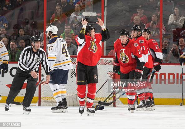 Chris Neil of the Ottawa Senators raises his arms to pump up the crowd after a fight in a game against of the Buffalo Sabres at Canadian Tire Centre...