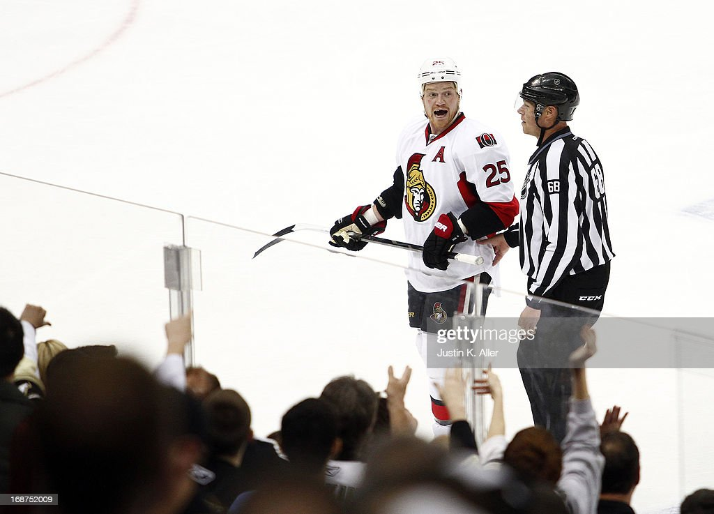 Chris Neil #25 of the Ottawa Senators receives a game misconduct at the end of the game against the Pittsburgh Penguins in Game One of the Eastern Conference Semifinals during the 2013 NHL Stanley Cup Playoffs at Consol Energy Center on May 14, 2013 in Pittsburgh, Pennsylvania. The Penguins defeated the Senators 4-1.
