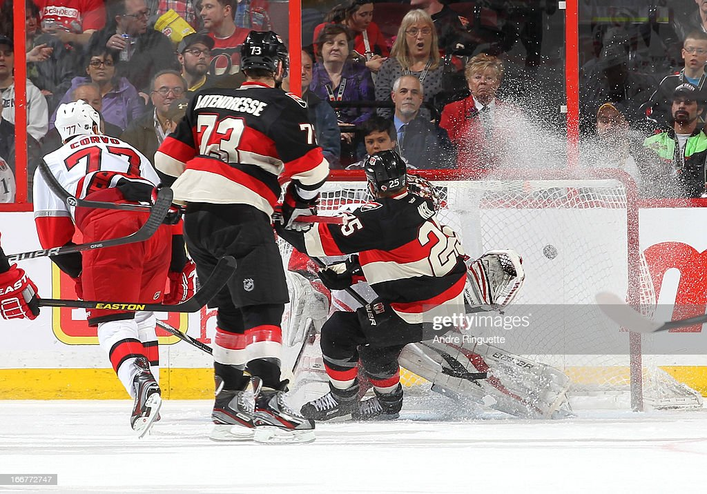 Chris Neil #25 of the Ottawa Senators redirects a pass from teammate <a gi-track='captionPersonalityLinkClicked' href=/galleries/search?phrase=Guillaume+Latendresse&family=editorial&specificpeople=848999 ng-click='$event.stopPropagation()'>Guillaume Latendresse</a> #73 past Justin Peters #35 of the Carolina Hurricanes for a second period goal on April 16, 2013 at Scotiabank Place in Ottawa, Ontario, Canada.