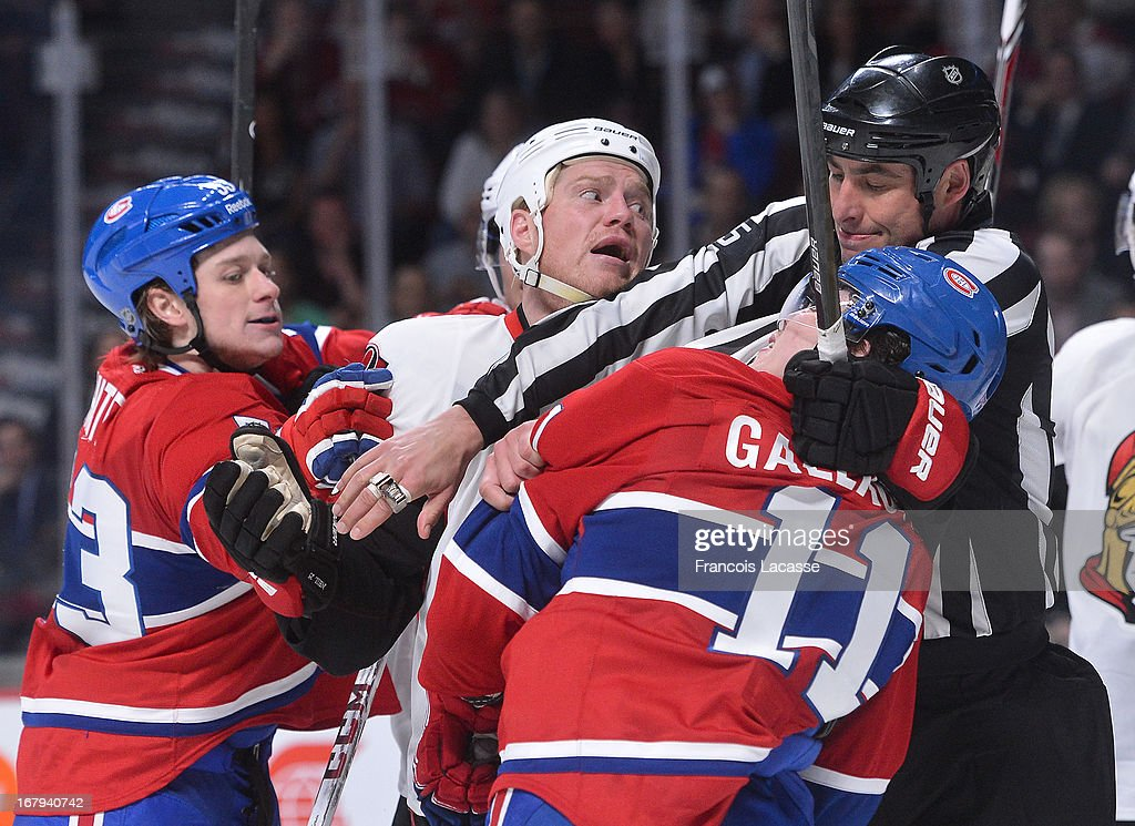 Chris Neil #25 of the Ottawa Senators scuffles with <a gi-track='captionPersonalityLinkClicked' href=/galleries/search?phrase=Brendan+Gallagher&family=editorial&specificpeople=3704208 ng-click='$event.stopPropagation()'>Brendan Gallagher</a> #11 of the Montreal Canadiens in Game One of the Eastern Conference Quarterfinals during the 2013 NHL Stanley Cup Playoffs at the Bell Centre on May 2, 2013 in Montreal, Quebec, Canada.