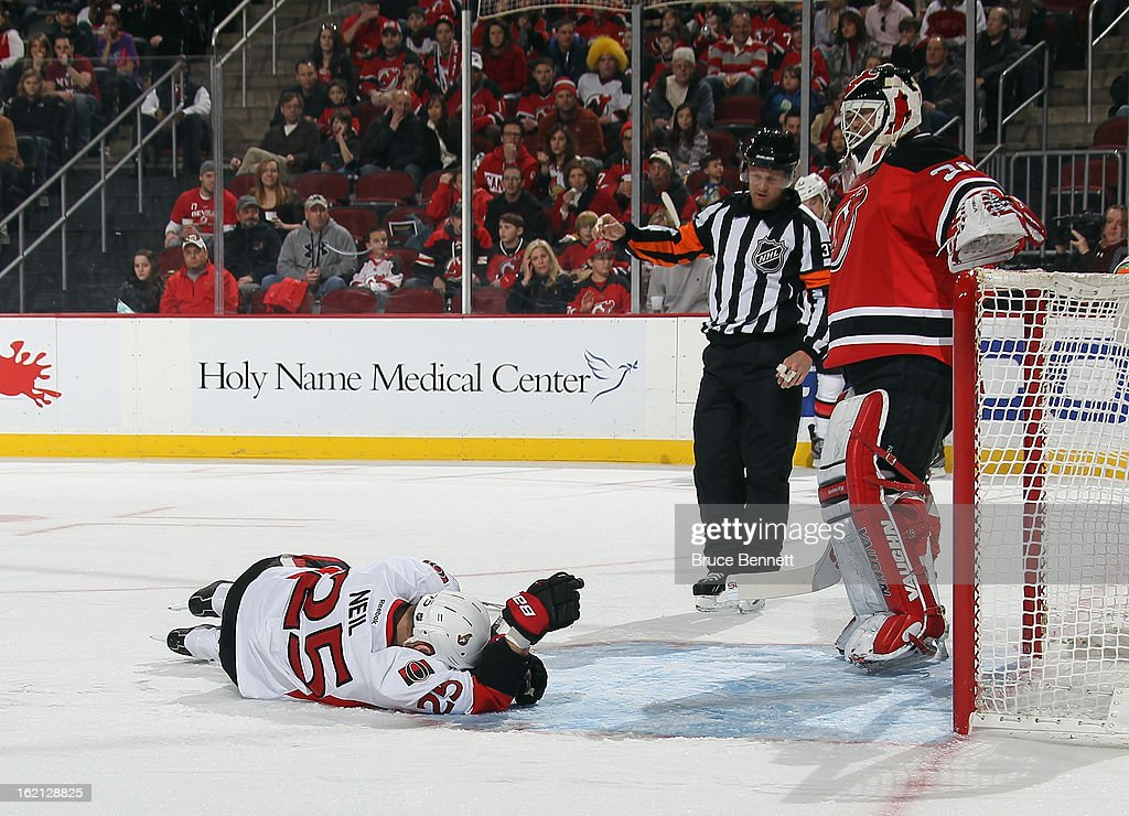 Chris Neil #25 of the Ottawa Senators shows the effects of a first period injury against the New Jersey Devils at the Prudential Center on February 18, 2013 in Newark, New Jersey.