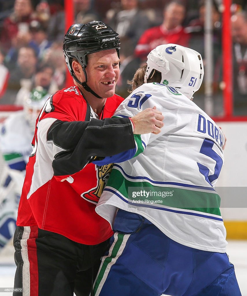 Chris Neil of the Ottawa Senators smiles during a fight with Derek Dorsett of the Vancouver Canucks at Canadian Tire Centre on December 7 2014 in...