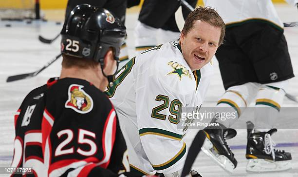 Chris Neil of the Ottawa Senators talks with Steve Ott of the Dallas Stars during warmups prior to a game at Scotiabank Place on November 24 2010 in...