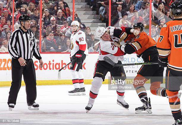 Chris Neil of the Ottawa Senators throws punches against Clayton Stoner of the Anaheim Ducks at Canadian Tire Centre on March 26 2016 in Ottawa...