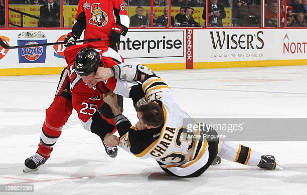 Chris Neil of the Ottawa Senators throws Zdeno Chara of the Boston Bruins to the ice in a fight at Scotiabank Place on February 25 2012 in Ottawa...