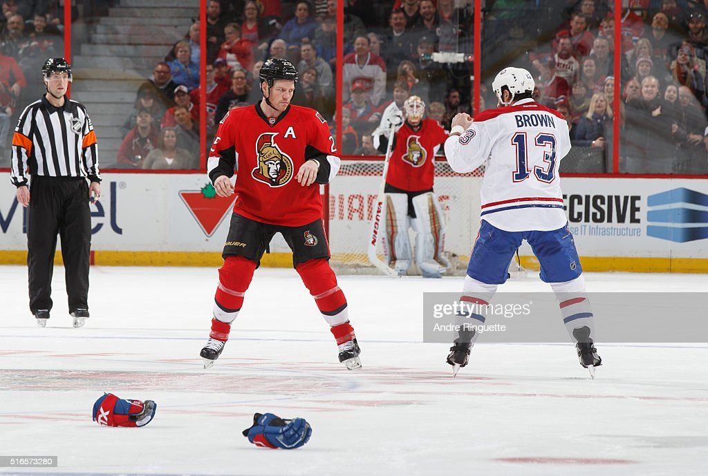 Chris Neil of the Ottawa Senatorsand Mike Brown of the Montreal Canadiens drop the gloves and prepare to fight at Canadian Tire Centre on March 19...