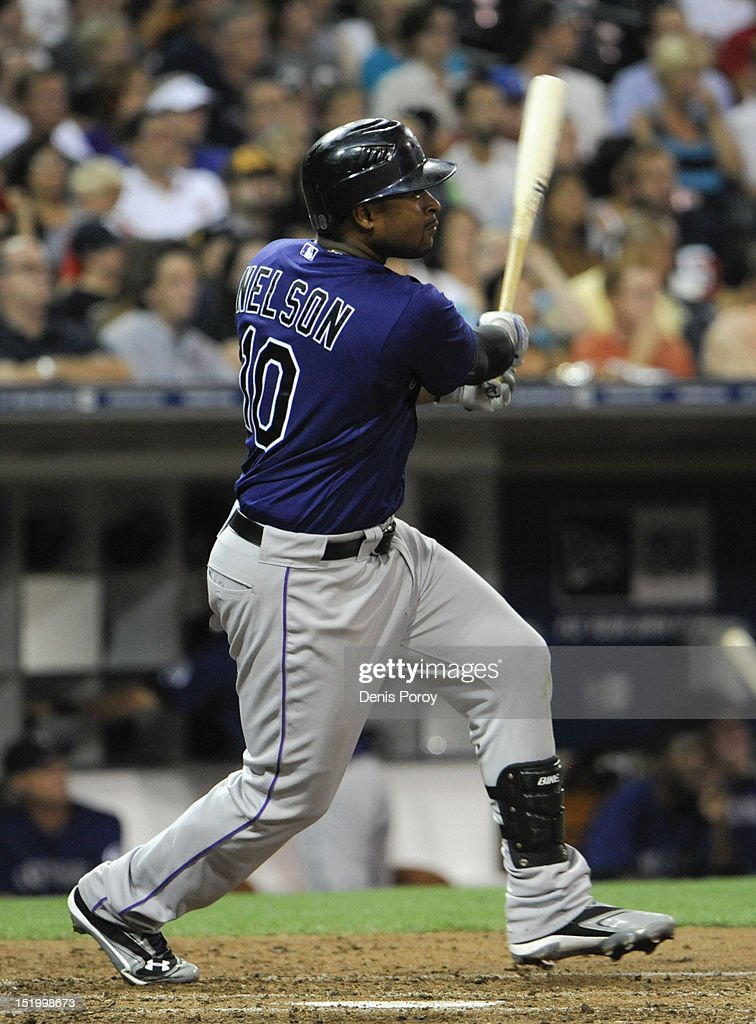 Chris Nelson #10 of the Colorado Rockies hits a double during the fifth inning of a baseball game against the San Diego Padres at Petco Park on September 14, 2012 in San Diego, California.