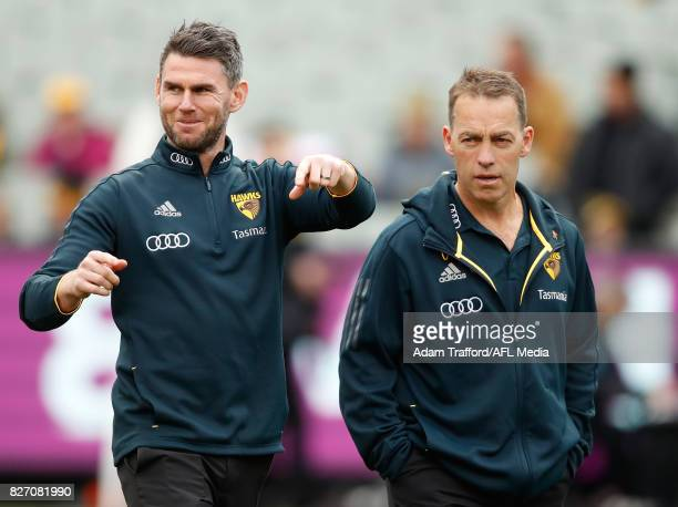 Chris Newman Senior Coach of the Box Hill Hawks chats to Alastair Clarkson Senior Coach of the Hawks during the 2017 AFL round 20 match between the...