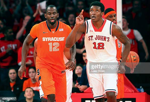 Chris Obekpa of the St John's Red Storm reacts after a play as Baye Moussa Keita of the Syracuse Orange looks on during the game at Madison Square...
