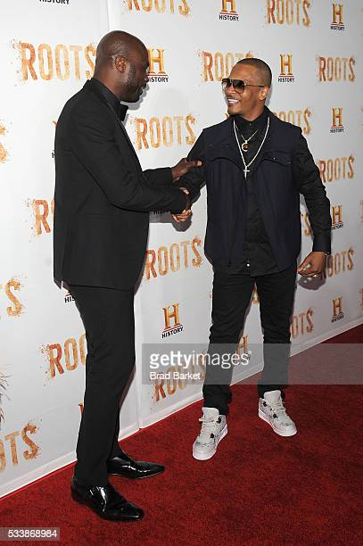 Chris Obi and Tip 'TI Harris attend the premiere screening of 'Night One' of the four night epic event series 'Roots' hosted by HISTORY at Alice...