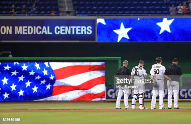 Chris O'Grady and JT Realmuto of the Miami Marlins look on during a game against the Cincinnati Reds at Marlins Park on July 27 2017 in Miami Florida