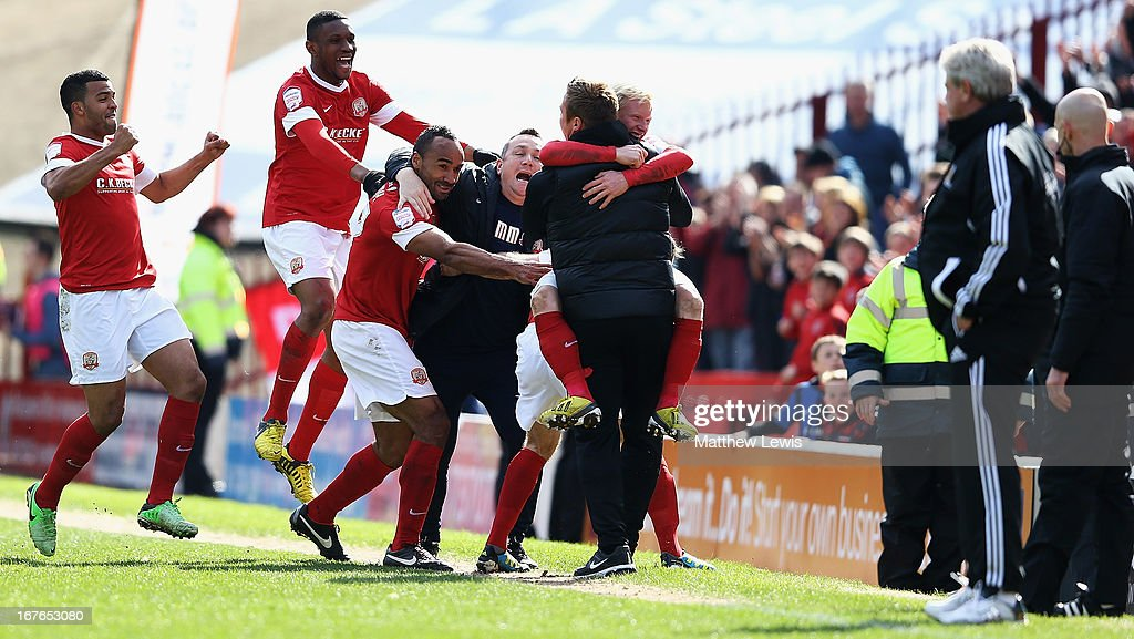 Chris O'Grady (c) of Barnsley celebrates his goal during the npower Championship match between Barnsley and Hull City at Oakwell Stadium on April 27, 2013 in Barnsley, England.