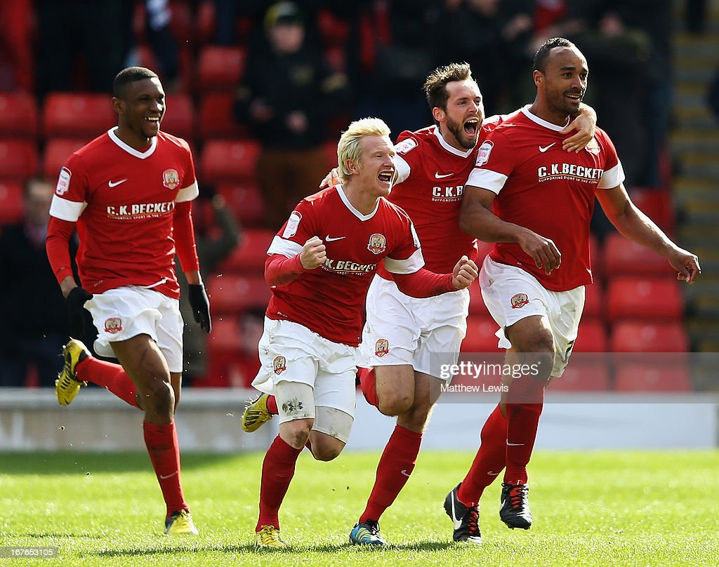 Chris O'Grady (R) of Barnsley celebrates his goal with team mates during the npower Championship match between Barnsley and Hull City at Oakwell Stadium on April 27, 2013 in Barnsley, England.