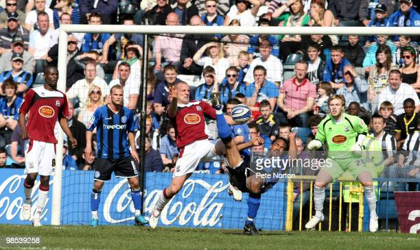Chris O'Grady of Rochdale attempts an overhead kick under pressure from Andy Holt of Northampton Town during the Coca Cola League Two Match between...