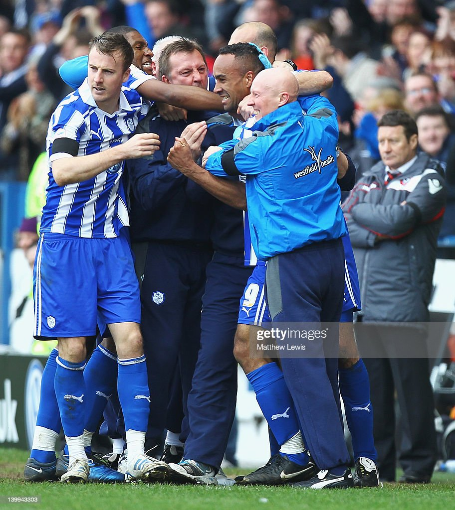 Chris O'Grady of Sheffield Wednesday celebrates his goal with the bench during the npower League One match between Sheffield Wednesday and Sheffield United at Hillsborough Stadium on February 26, 2012 in Sheffield, England.