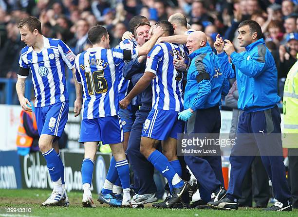 Chris O'Grady of Sheffield Wednesday celebrates his goal with the bench during the npower League One match between Sheffield Wednesday and Sheffield...