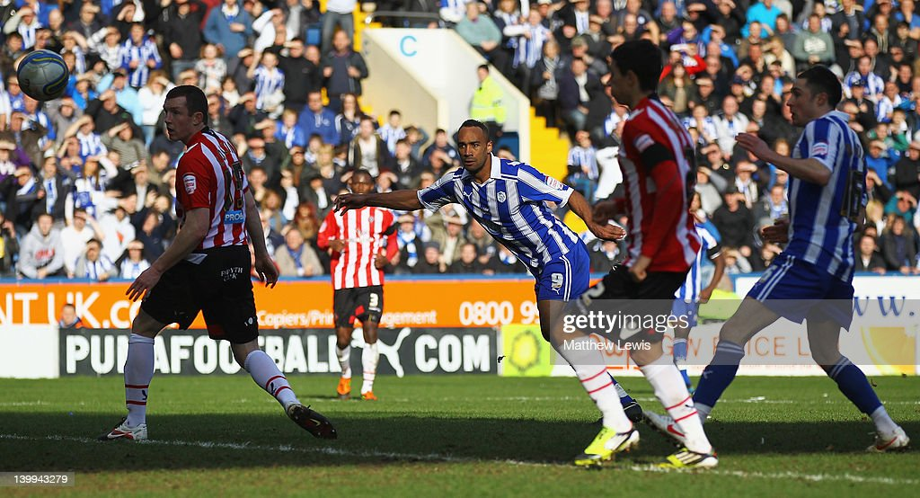 Chris O'Grady of Sheffield Wednesday looks on, after his header beats Steve Simonsen of Sheffield United to score a goal during the npower League One match between Sheffield Wednesday and Sheffield United at Hillsborough Stadium on February 26, 2012 in Sheffield, England.