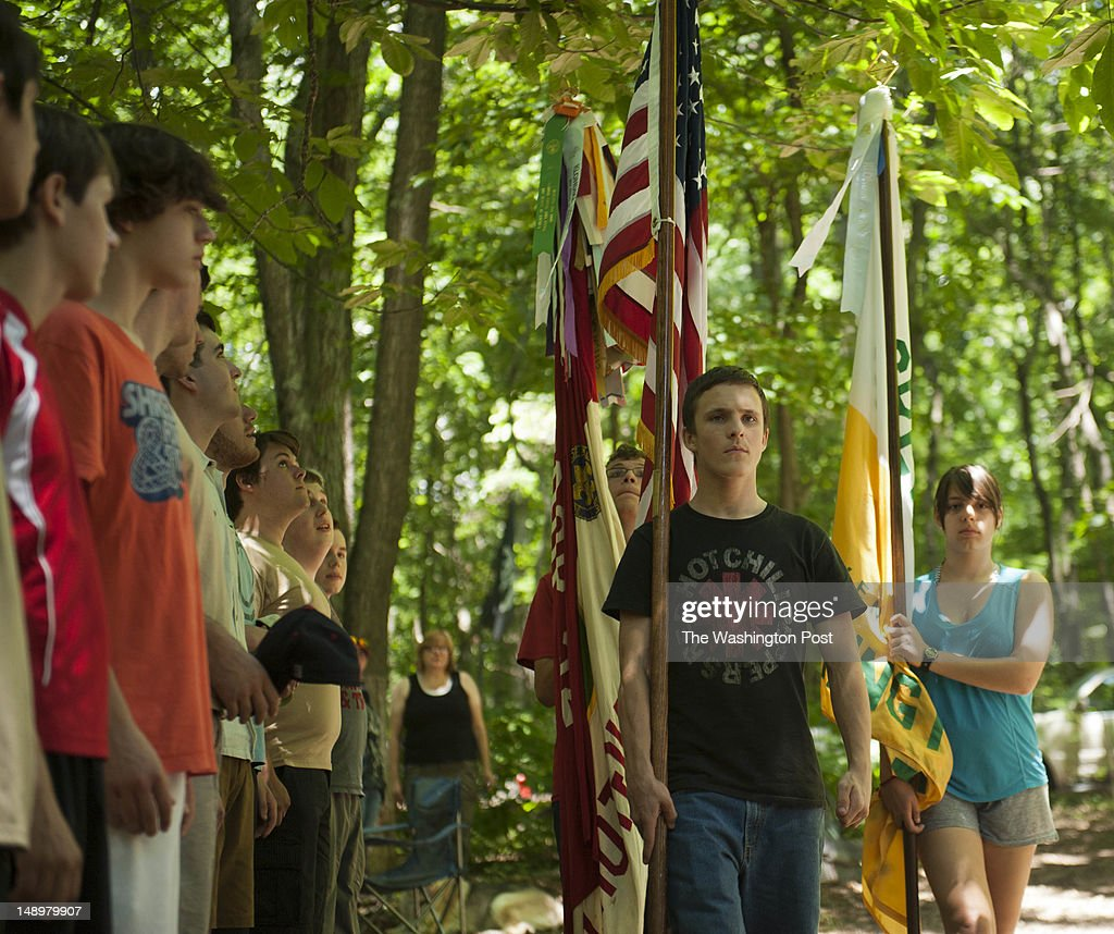 Chris O'Neil, 16 (center) and Ariella Knab, 16 (right) is part of The Color Guard presenting the colors for the Flag Ceremony in Germantown, Maryland on June 23, 2012. TROOP52: The 100-year-old Boy Scout troop 52 in the Washington area is also one of the oldest in the nation. Troop 52 kicks off it's centennial year celebration at it's Camp Seneca retreat today.