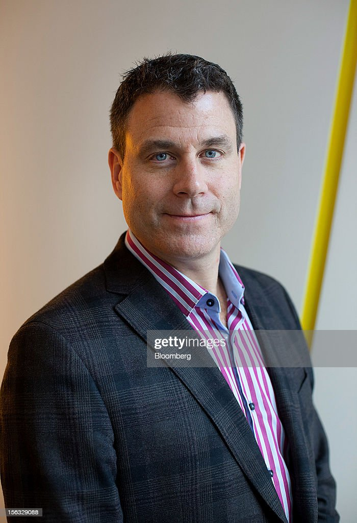 Chris O'Neil, managing director of Google Inc. Canada, stands for a photograph during a media tour for the grand opening of Google Inc.'s new office in Toronto, Ontario, Canada, on Tuesday, Nov. 13, 2012. The office space encompasses five color-coded floors and features amenities such as a pool table, video games, mini-golf putting greens and a camping lounge where employees can hold meetings in a tent. Photographer: Brett Gunlock/Bloomberg via Getty Images