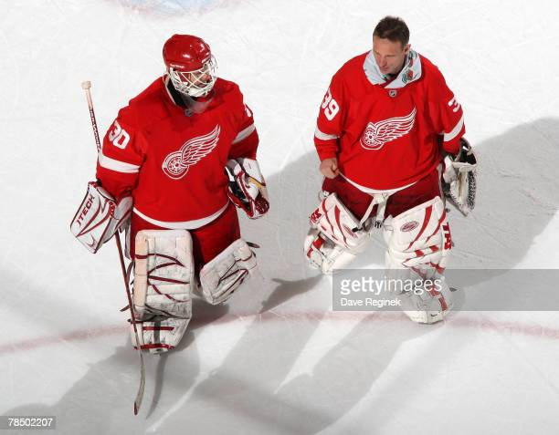 Chris Osgood and Dominik Hasek of the Detroit Red Wings skate off the ice together after their win over the Florida Panthers 52 at Joe Louis Arena...