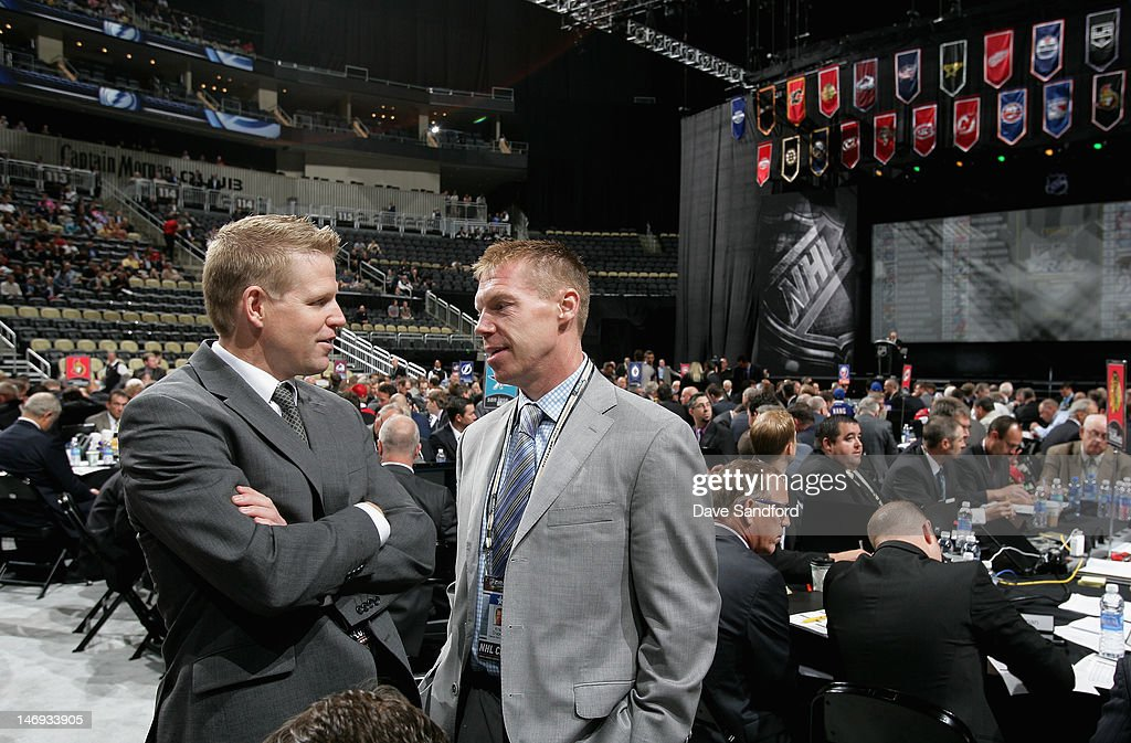 Chris Osgood (R) and Kris Draper of the Detroit Red Wings attend day two of the 2012 NHL Entry Draft at Consol Energy Center on June 23, 2012 in Pittsburgh, Pennsylvania.