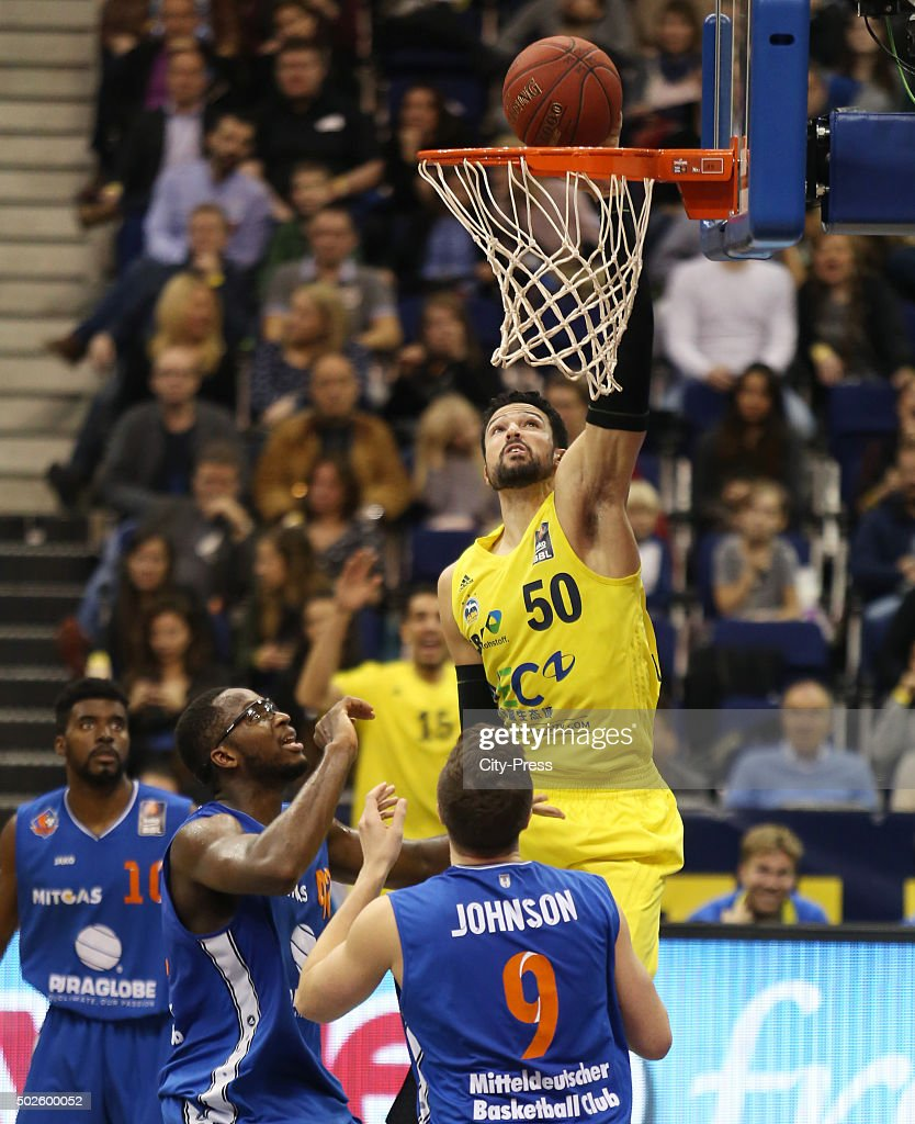 Chris Otule, Dominique Johnson of Mitteldeutscher BC and Mitchell Watt of ALBA Berlin during the game between Alba Berlin and Mitteldeutscher BC on December 27, 2015 in Berlin, Germany.