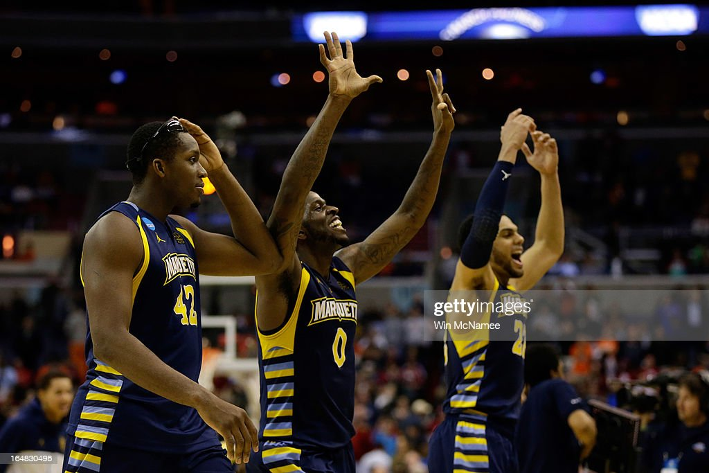 Chris Otule #42, Jamil Wilson #0 and Trent Lockett #22 of the Marquette Golden Eagles celebrate after defeating the Miami (Fl) Hurricanes during the East Regional Round of the 2013 NCAA Men's Basketball Tournament at Verizon Center on March 28, 2013 in Washington, DC.