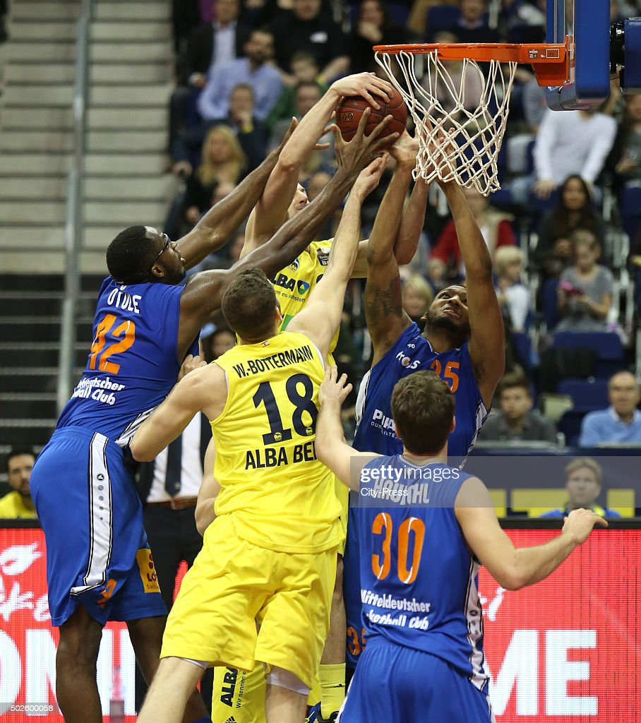 Chris Otule of Mitteldeutscher BC, Jonas Wohlfarth-Bottermann of ALBA Berlin, Oliver Clay and Stephan Haukohl of Mitteldeutscher BC during the game between Alba Berlin and Mitteldeutscher BC on December 27, 2015 in Berlin, Germany.