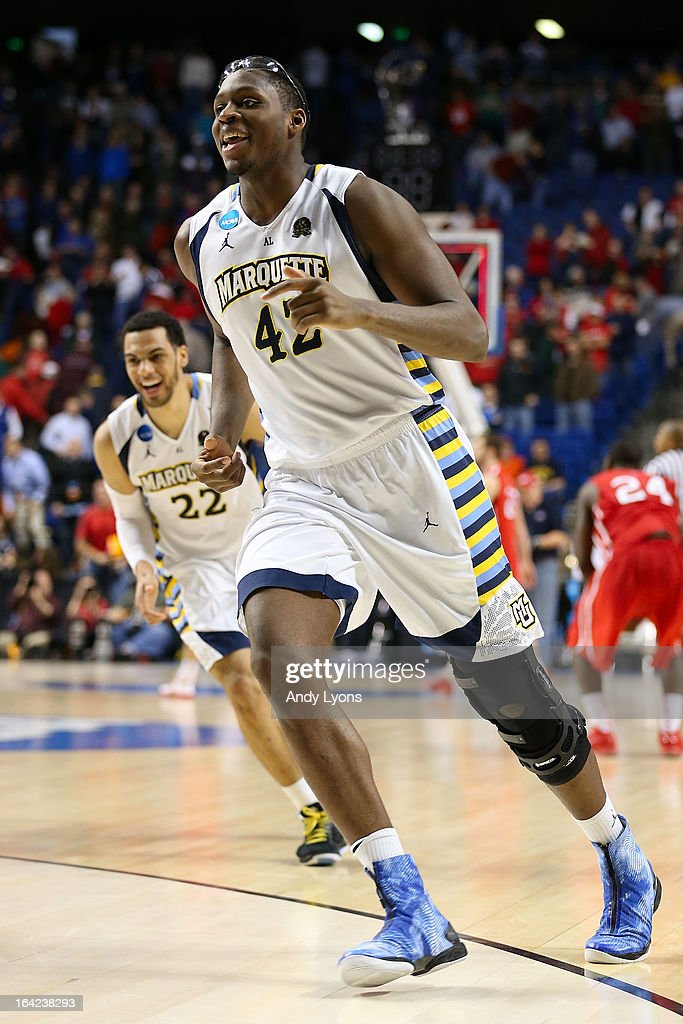 Chris Otule #42 of the Marquette Golden Eagles celebrates their 59-58 win over the Davidson Wildcats during the second round of the 2013 NCAA Men's Basketball Tournament at the Rupp Arena on March 21, 2013 in Lexington, Kentucky.