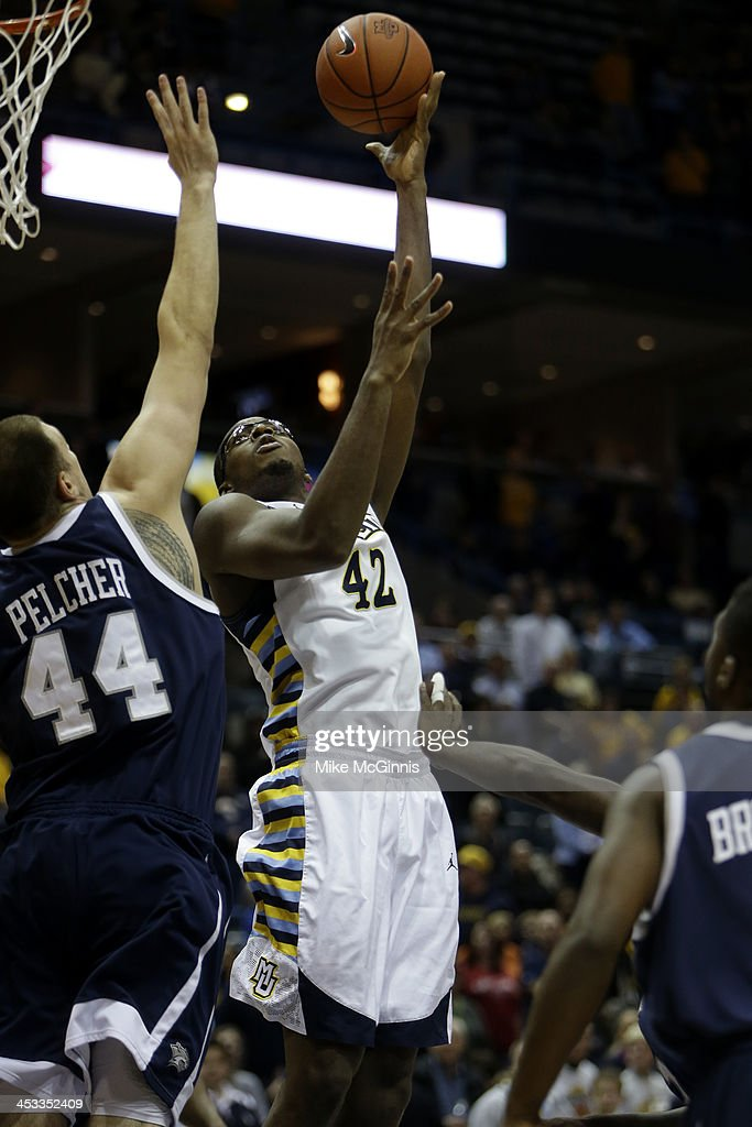 Chris Otule #42 of the Marquette Golden Eagles pulls up with a jump hook during the game against the New Hampshire Wildcats at BMO Harris Bradley Center on November 21, 2013 in Madison, Wisconsin.