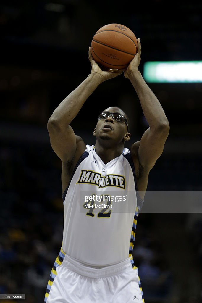 Chris Otule #42 of the Marquette Golden Eagles shoots a free throw during the game against the Ball State Cardinals at BMO Harris Bradley Center on December 17, 2013 in Madison, Wisconsin.