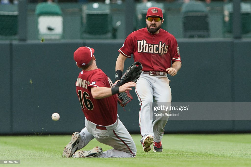 Chris Owings #16 and <a gi-track='captionPersonalityLinkClicked' href=/galleries/search?phrase=Adam+Eaton&family=editorial&specificpeople=210898 ng-click='$event.stopPropagation()'>Adam Eaton</a> #6 of the Arizona Diamondbacks are unable to come up with the ball in shallow center during the fourth inning of a game against the Colorado Rockies at Coors Field on September 22, 2013 in Denver, Colorado.