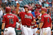 Chris Owings Jordan Pacheco and Cliff Pennington of the Arizona Diamondbacks celebrate after scoring against the Los Angeles Dodgers during the MLB...