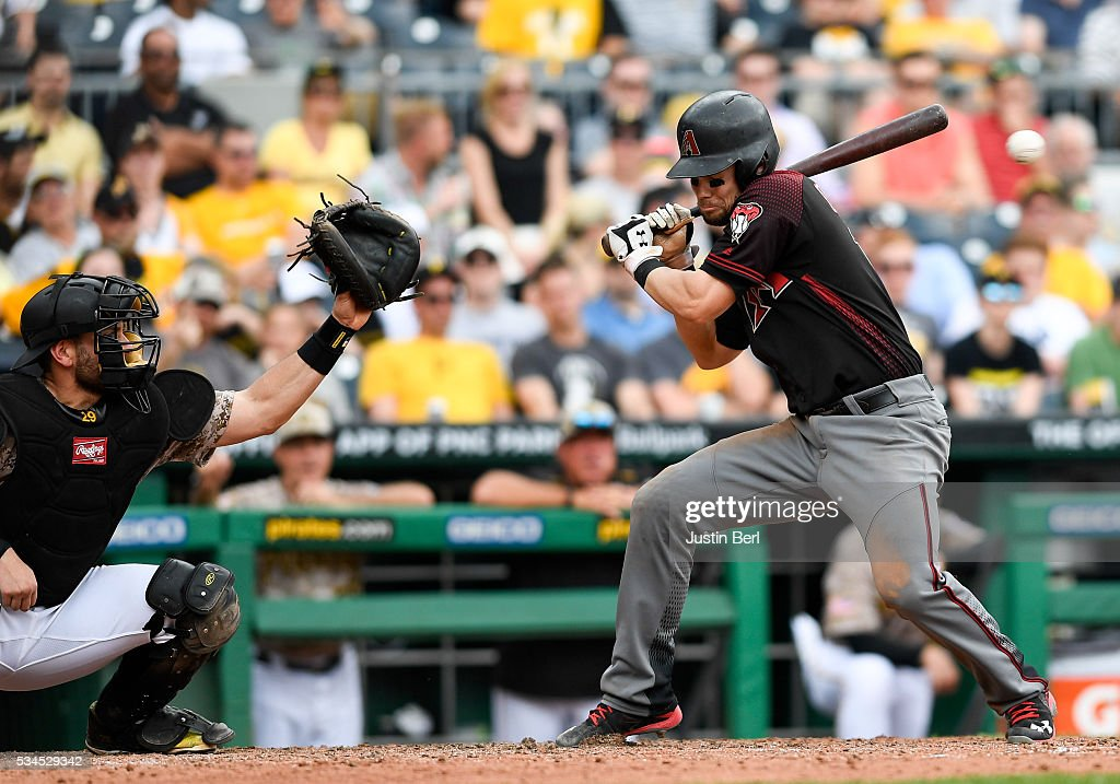 Chris Owings #16 of the Arizona Diamondbacks attempts to turn away from a high pitch by Rob Scahill #52 of the Pittsburgh Pirates in the seventh inning during the game at PNC Park on May 26, 2016 in Pittsburgh, Pennsylvania.