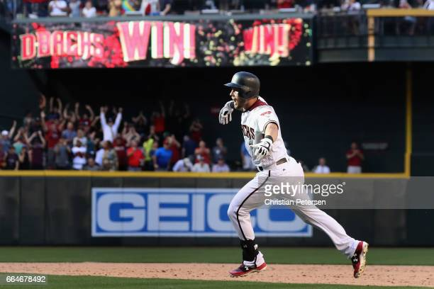 Chris Owings of the Arizona Diamondbacks celebrates after hitting the game winning RBI single against the San Francisco Giants during the ninth...