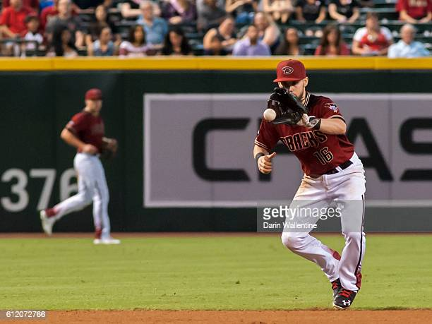 Chris Owings of the Arizona Diamondbacks fields a grounder in the ninth inning of the MLB game against the San Diego Padres at Chase Field on October...