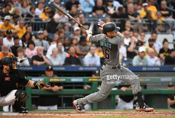 Chris Owings of the Arizona Diamondbacks hits an RBI double in the sixth inning during the game against the Pittsburgh Pirates at PNC Park on May 30...