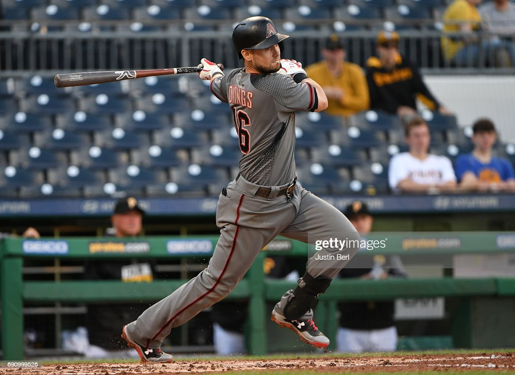 Chris Owings #16 of the Arizona Diamondbacks hits an RBI single to right field in the 14th inning against the Pittsburgh Pirates at PNC Park on May 31, 2017 in Pittsburgh, Pennsylvania.